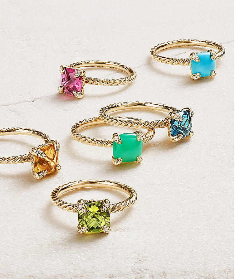Châtelaine® rings in 18K yellow gold with turquoise, pink tourmaline, Hampton Blue Topaz, chrysoprase, citrine and peridot on a stone.