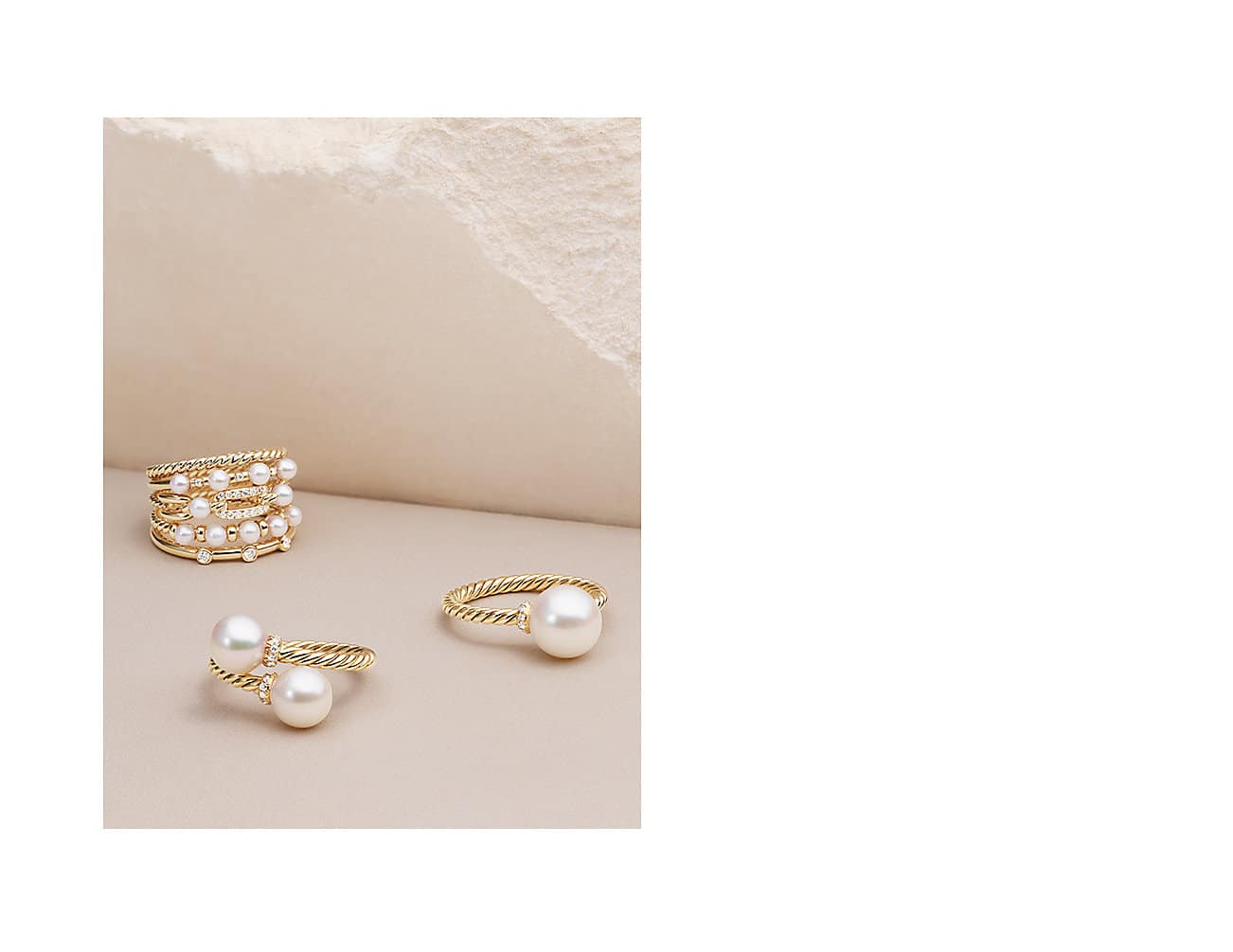 Petite Perle and Solari rings in 18K yellow gold with cultured freshwater pearls and diamonds.