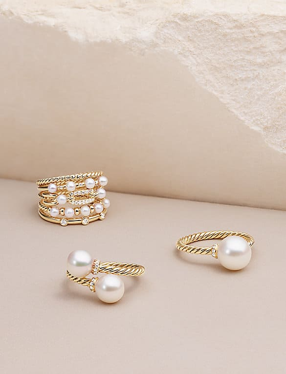 Petite Perle and Solari rings in 18K yellow gold with cultured pearls and diamonds.