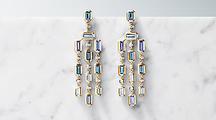 Gold earrings with colorful gemstones.
