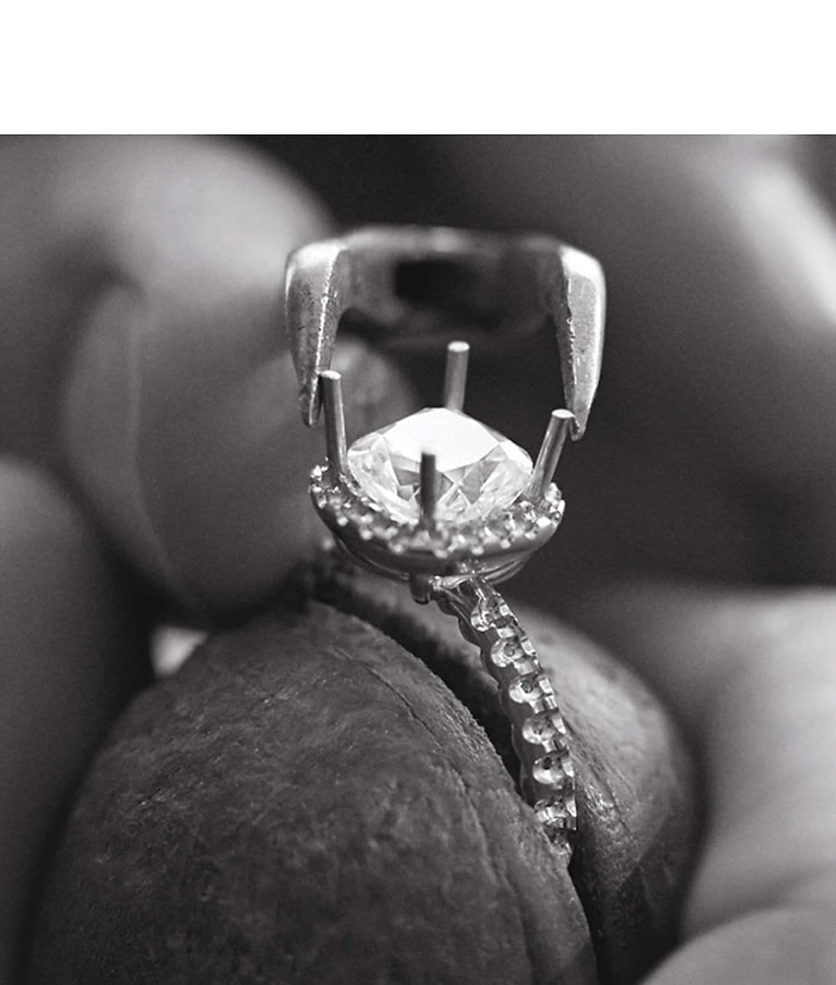 A diamond engagement ring in the process of being crafted
