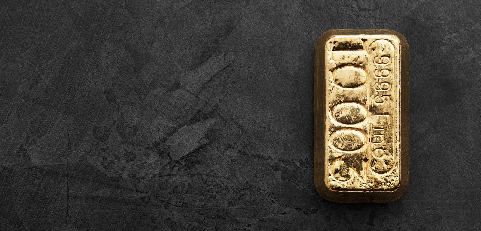 """A gold bar stamped with """"9995 Fine"""" on the top."""