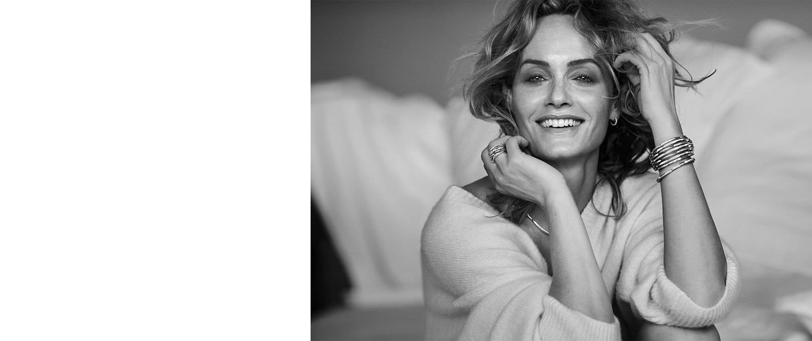 Model Amber Valletta wears multiple pieces of Tides jewelry in sterling silver with pavé white diamonds.