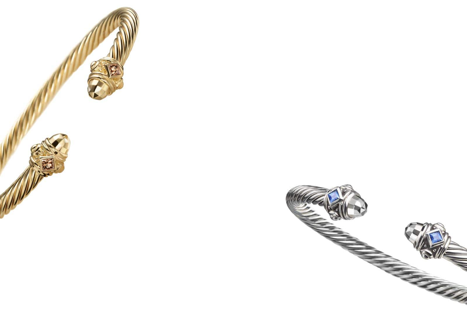 Un bracelet de la collection Renaissance en or jaune 18K avec diamants champagne incliné contre un fond blanc.