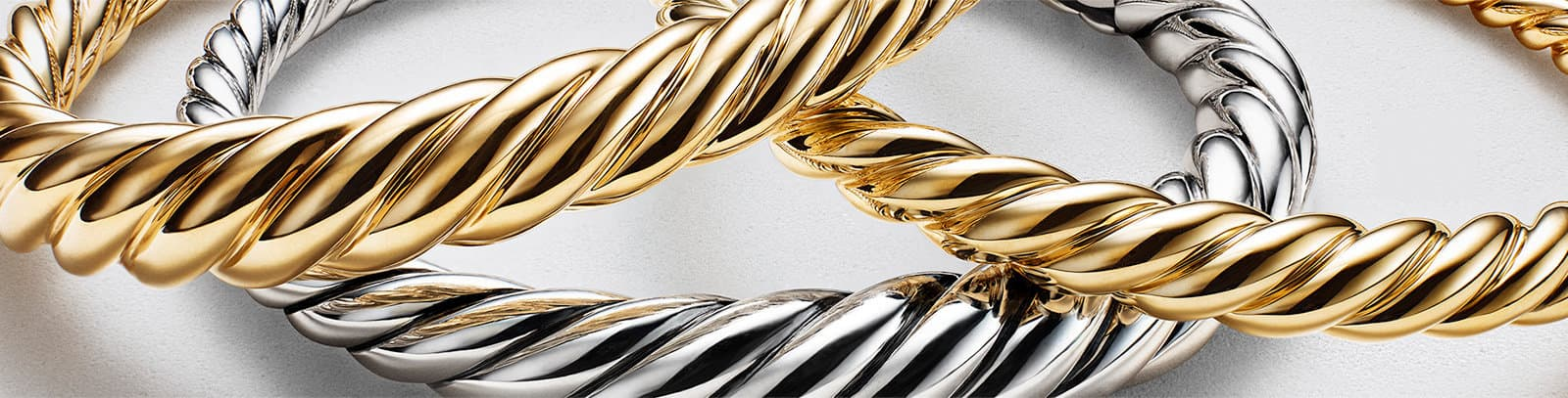 gold and silver cable bracelets