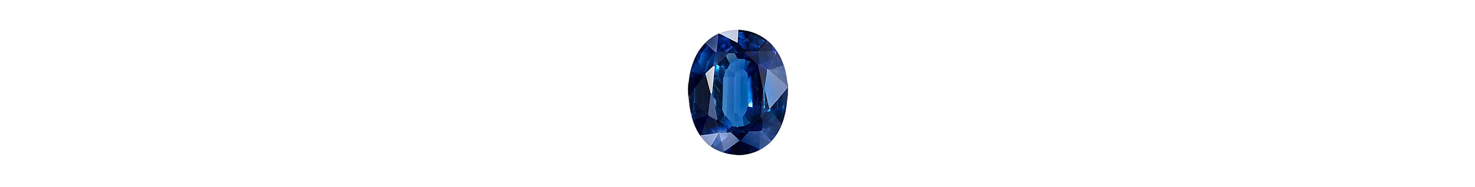 A color photograph shows a close-up shot of an oval-cut blue sapphire on a white background.