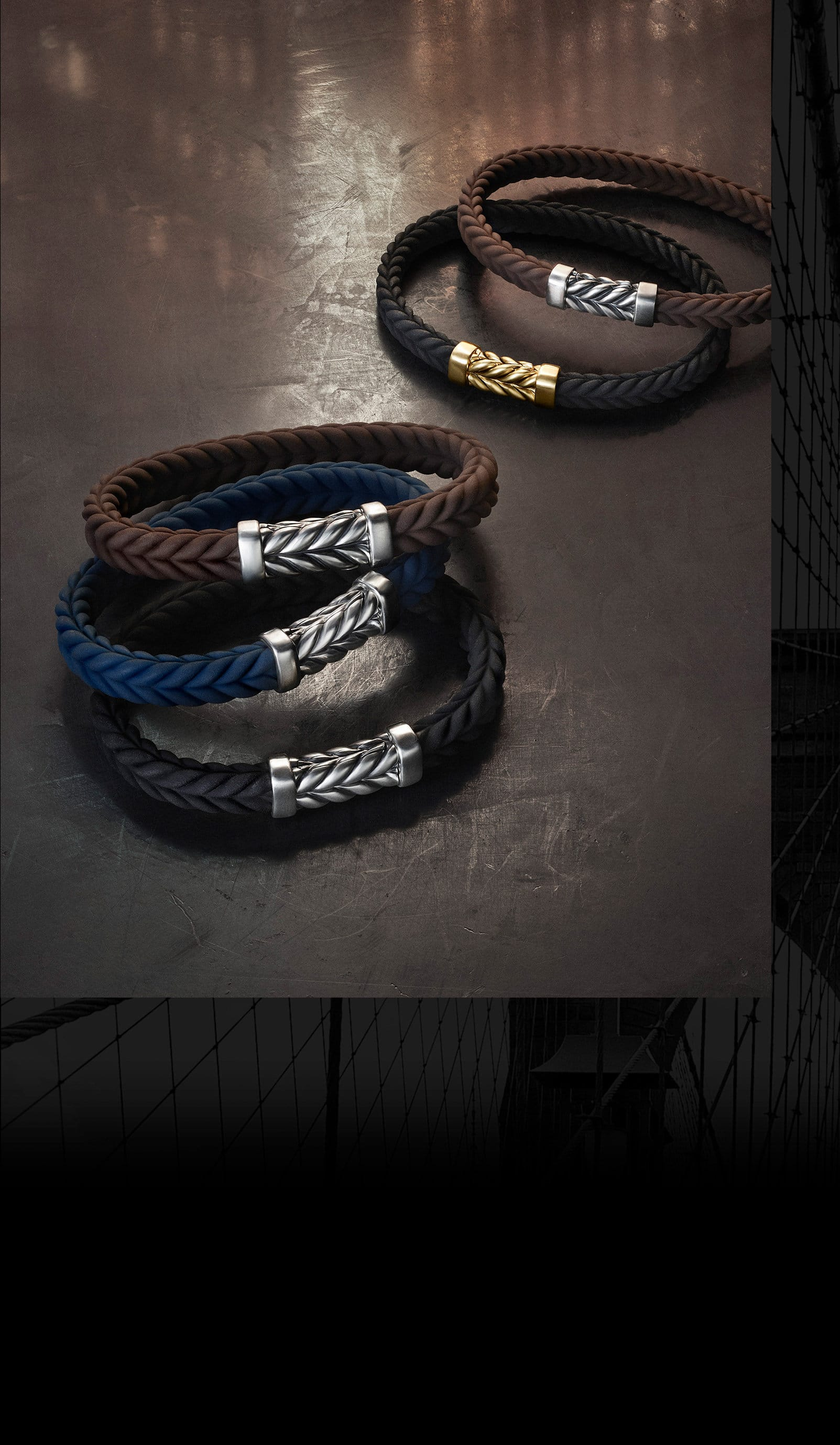 Five David Yurman men's Chevron bracelets. The jewelry is crafted from brown, blue or black rubber with sterling silver or 18K yellow gold clasps with Chevron detailing.