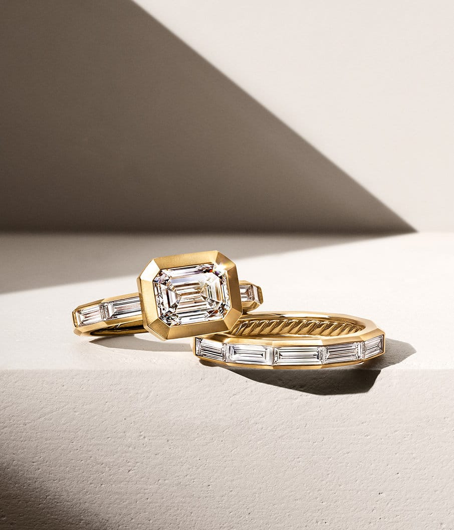 A color photograph shows a David Yurman Delaunay Engagment ring and band ring with baguette diamonds in 18K yellow gold