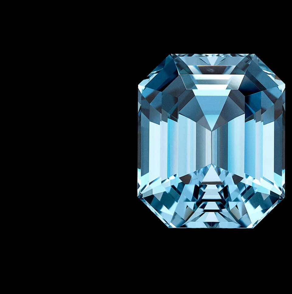 A color photo shows a loose aquamarine stone of exceptional size and color cut in distinct faceted shape and reflecting light.