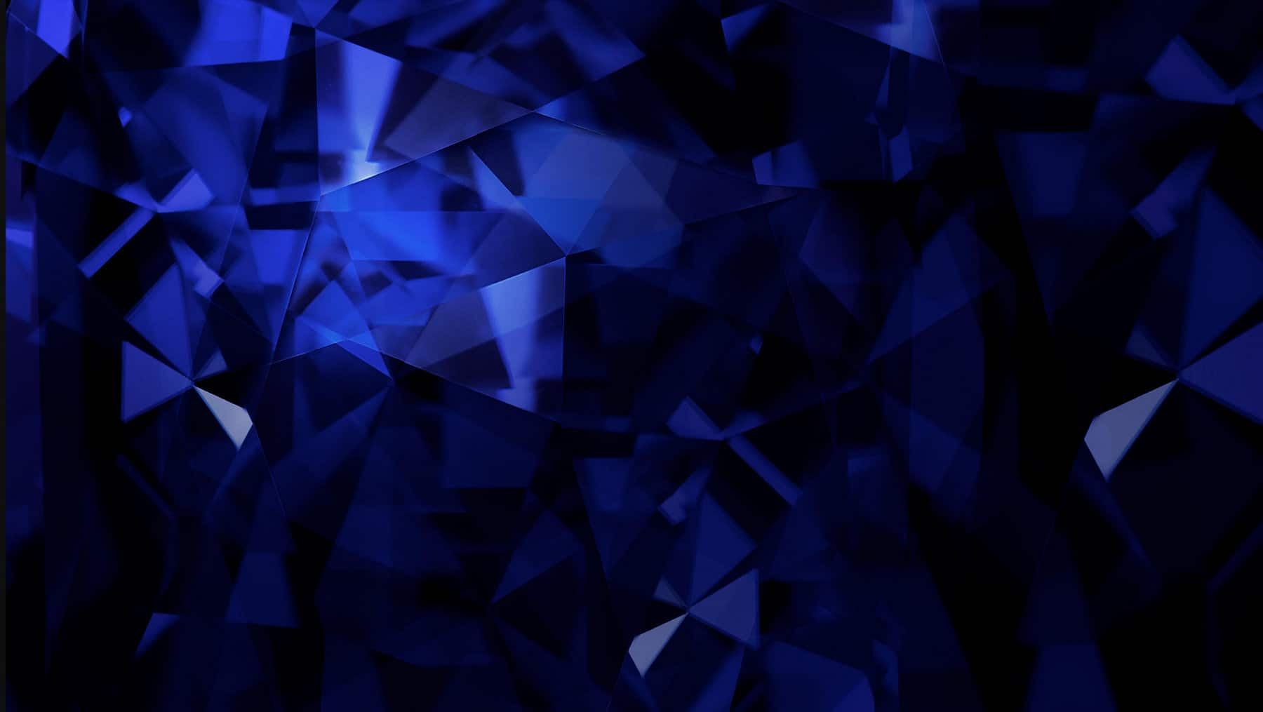 A color photo shows an extreme closeup of the many facets of translucent purplish-blue gemstone with hints of light reflected.