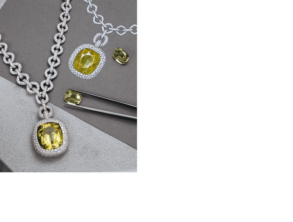 A High Jewelry pendant necklace in 18K white gold with pavé diamonds and a yellow beryl next to a gouache of the design and tweezers holding a yellow beryl gemstone.