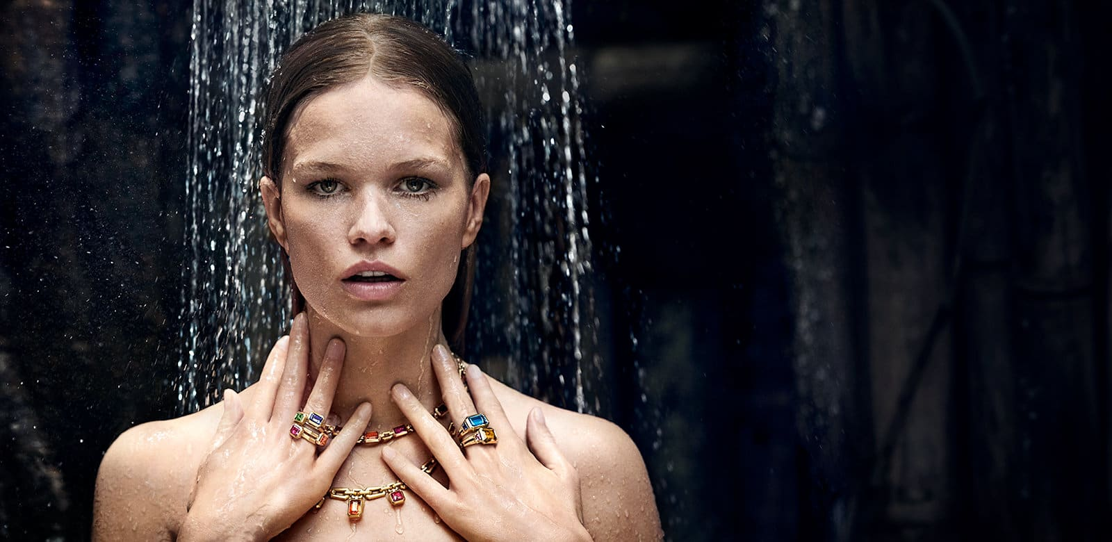 A color photo of model Anna Ewers wearing David Yurman Novella necklaces, gold chains and