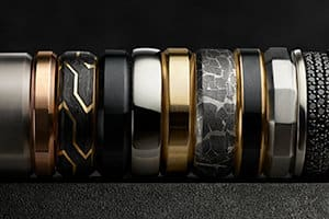 Multiple David Yurman men's bands in precious metals and innovative materials.