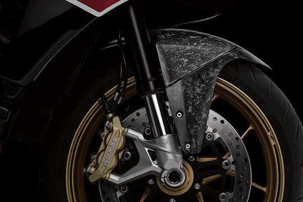 A color photo of a wheel and forged carbon fender on the David Yurman Forged Carbon Moto by MV Agusta.