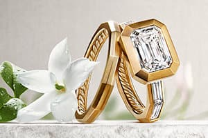 DY Delaunay engagement ring and band in 18K yellow gold with diamonds.
