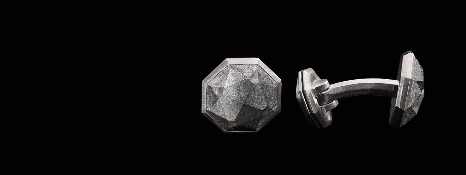 David Yurman men's Meteorite cufflinks on a black background
