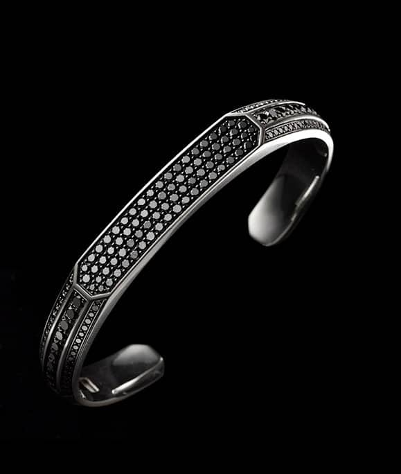 A Pavé cuff bracelet in sterling silver with black diamonds.