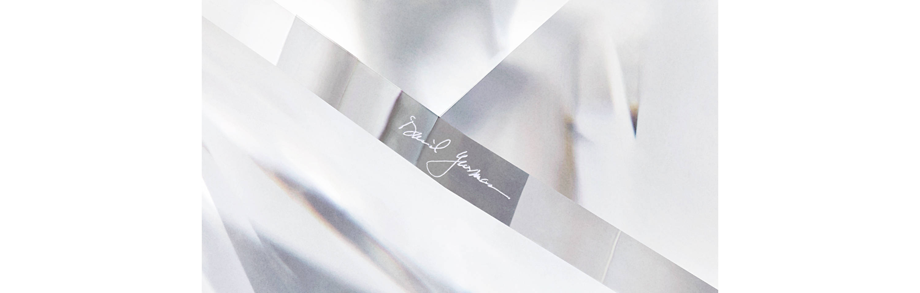 A close-up photo of a DY Signature Cut diamond showing the laser-engraved David Yurman signature at the girdle.