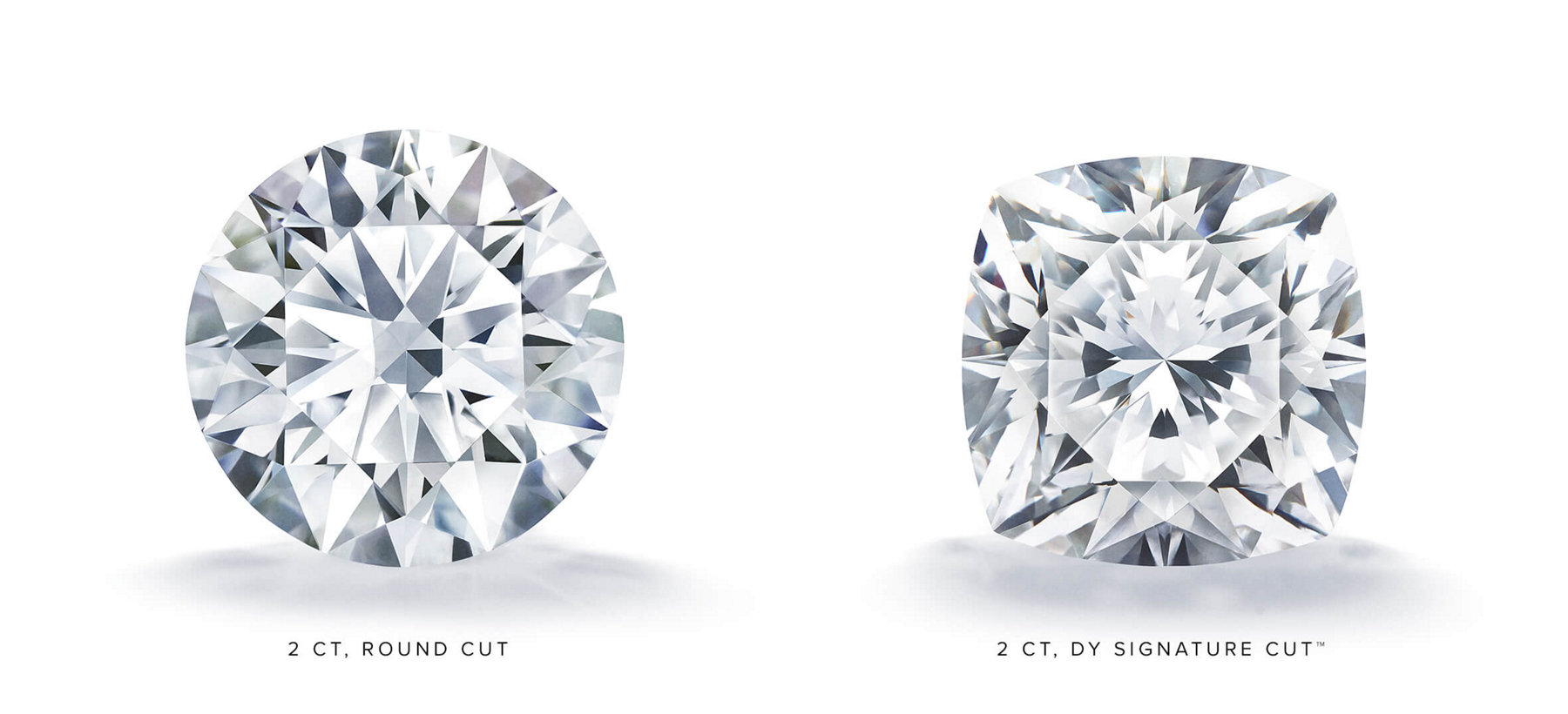 A 2-carat loose round brilliant diamond next to a 2-carat DY Signature Cut cushion-shape diamond on a white background with shadows underneath each stone.