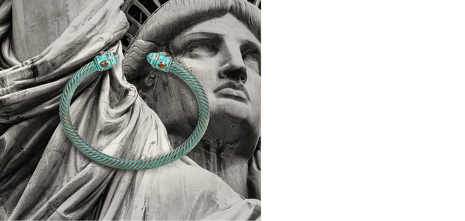A David Yurman Renaissance Collection bracelet in copper with a green patina atop an image of the Statue of Liberty.