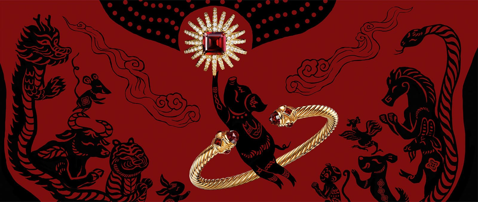 A red-and-black illustration with Chinese zodiac animals, including a pig. David Yurman Starburst designs in 18K yellow gold with garnet and a Cable bracelet in 18K gold are placed on top of the illustration.