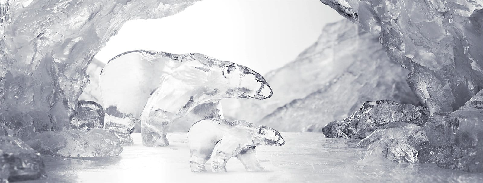 A family of two polar bears carved from ice in a bright ice cave.