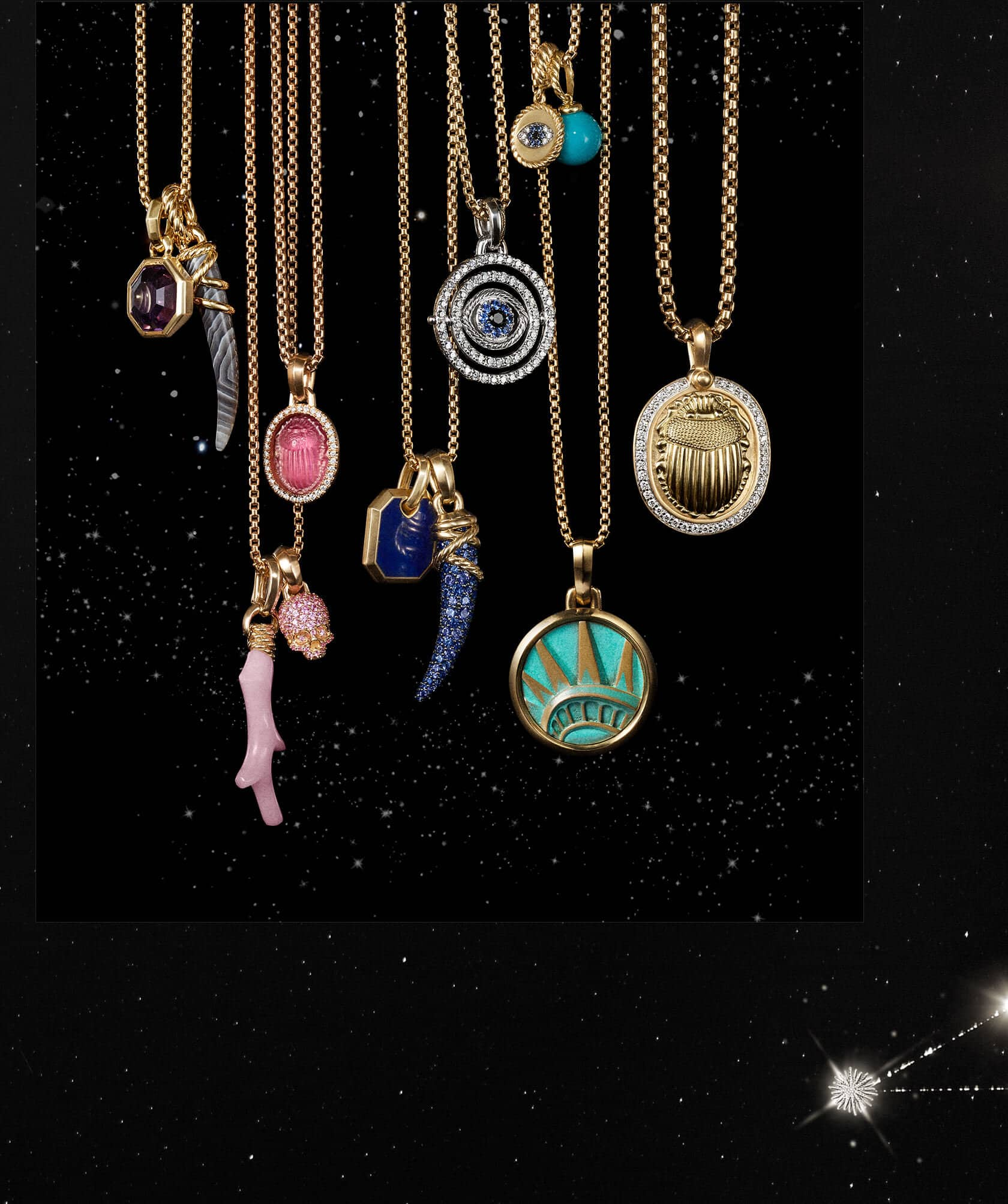 A color photograph shows 12 David Yurman amulet pendants hanging from a horizontal row of chain necklaces in front of a starry night sky. The women's jewelry is crafted from 18K yellow gold or sterling silver with or without pavé diamonds and an array of colored gemstones. The pendants come in various shapes such as a branch of coral, horn, dagger, or skull or depict a multitude of images such as a scarab and the Statue of Liberty's crown.