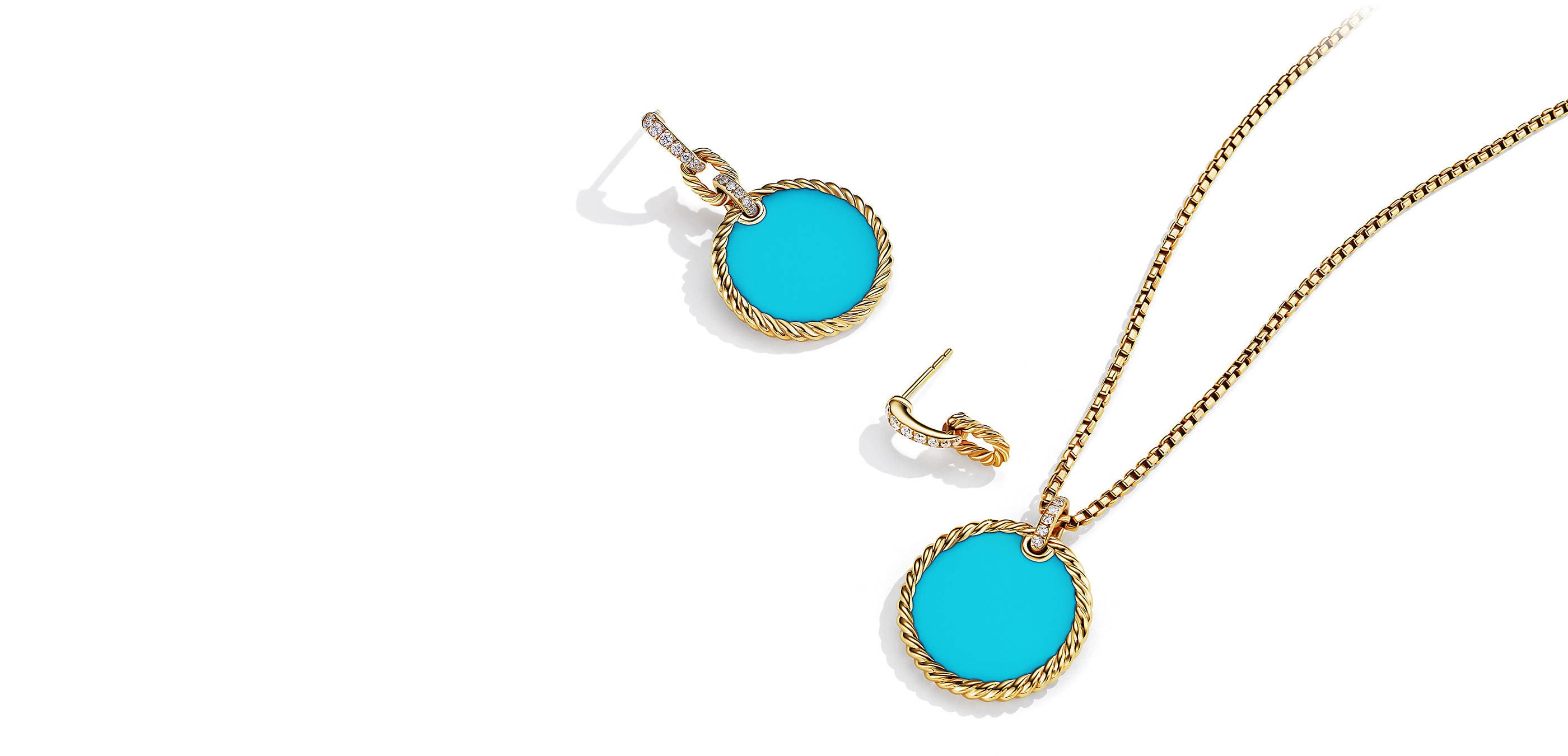 A color photo shows a DY Elements drop earring in 18K yellow gold with black onyx and pavé diamonds above the same earring with the gemstone drop removed on a white background. Below the second earring is a DY Elements circular turquoise pendant in 18K yellow gold strung on a sterling silver box chain.