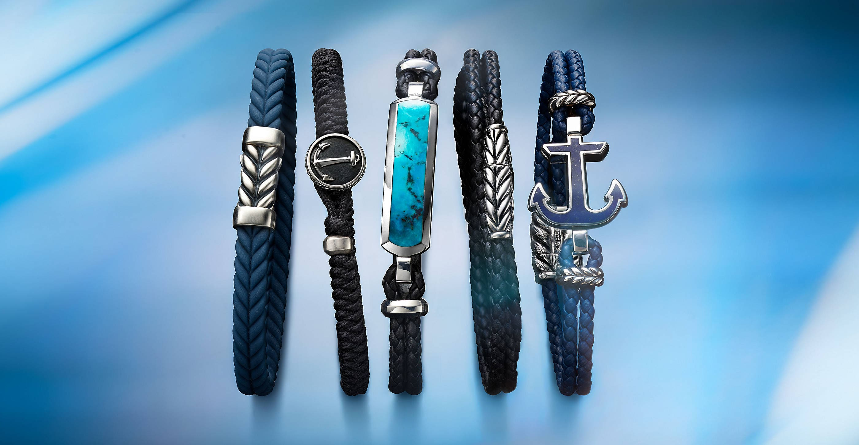 An image of five David Yurman braided or woven Chevron, Maritime and Exotic Stone bracelets, all crafted from sterling silver.
