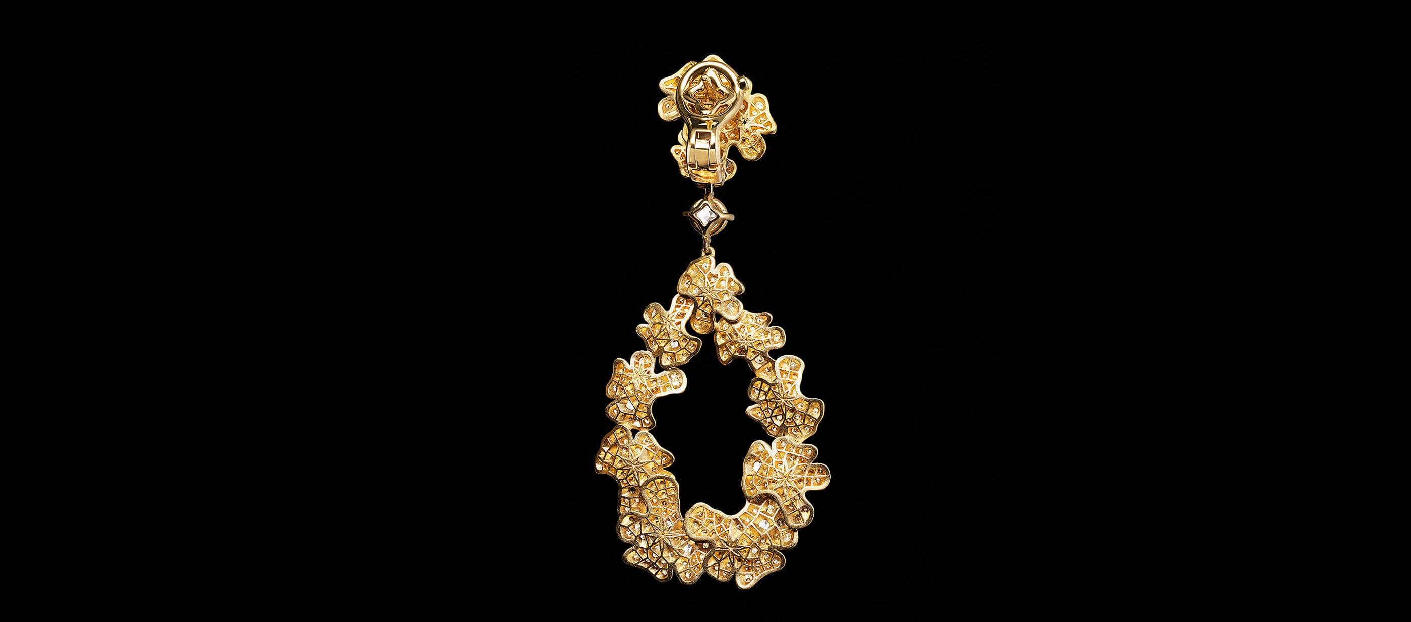 An image showing the back of a Yellow Gold HJ petals drop earring