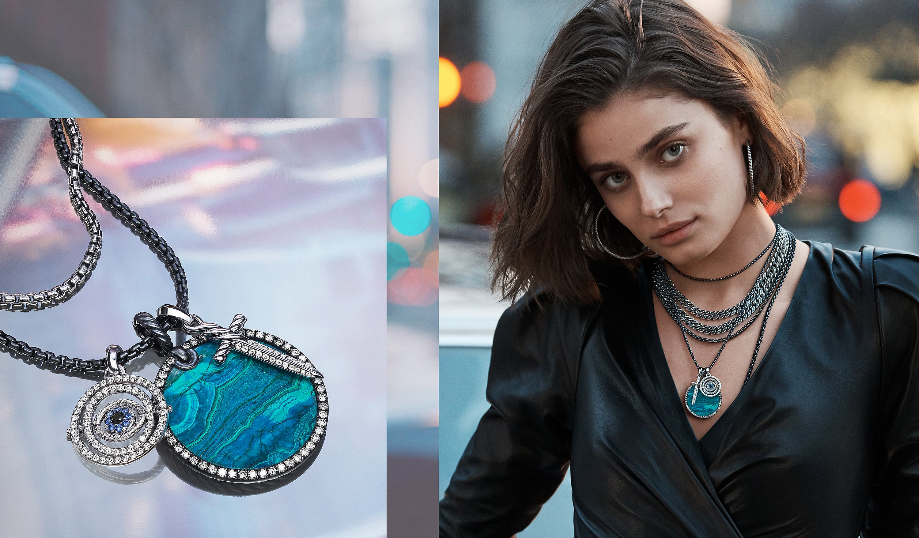 A photo collage shows two color photos side by side. On the left is a close-up shot of two David Yurman chains strung with three amulets (also shown right) on a colorful photo of NYC. The center amulet features a circular piece of chrysocolla surrounded by white diamonds. The other two amulets depict an evil eye and a dagger with white diamonds and blue sapphires. The jewelry is crafted from sterling silver, darkened sterling silver or 18K white gold. On the right is a photo of model Taylor Hill outside in NYC wearing a black dress and David Yurman hoop earrings and multiple chains with the same amulets shown left. The jewelry is crafted from darkened sterling silver or stainless steel or 18K white gold with black or white diamonds and sapphires.