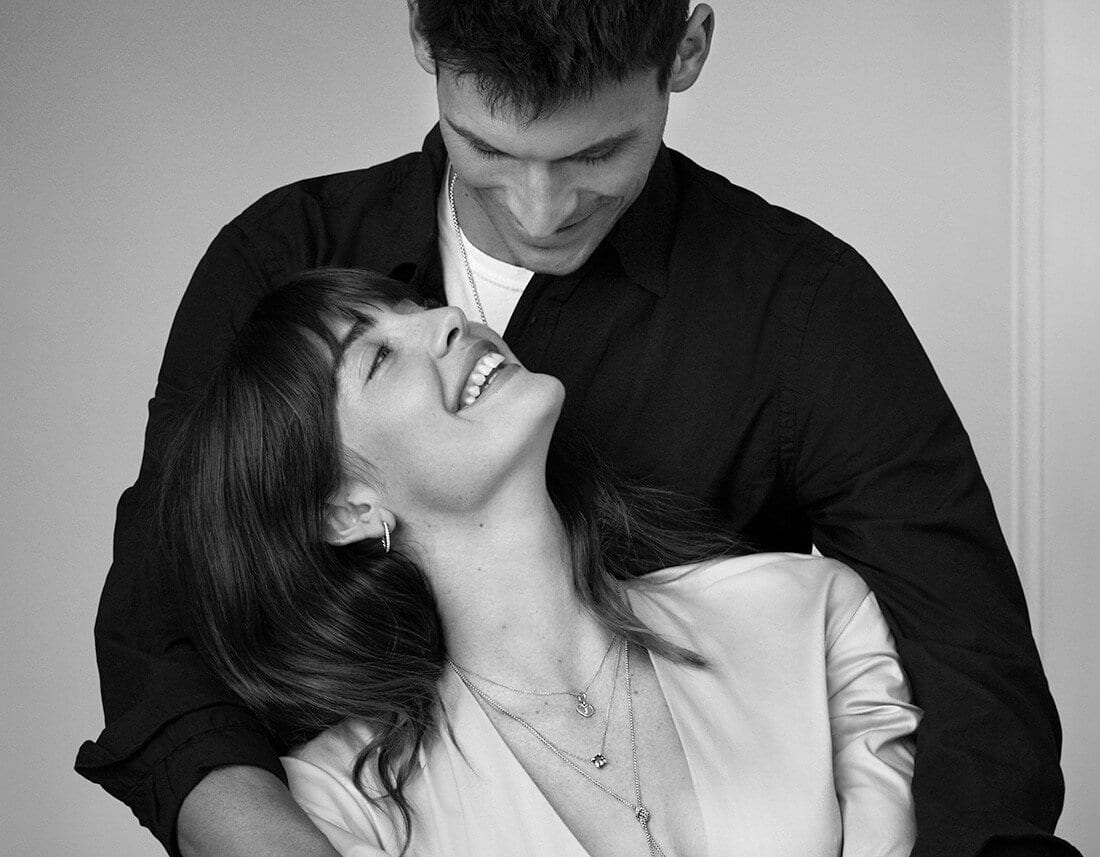 A black-and-white photo shows Juliette and Miles smiling while wearing various David Yurman jewelry designs.