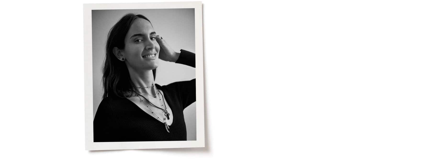 A black-and-white photo shows Jane with one hand behind her ear. She's wearing David Yurman jewelry, including various necklaces layered over each other.
