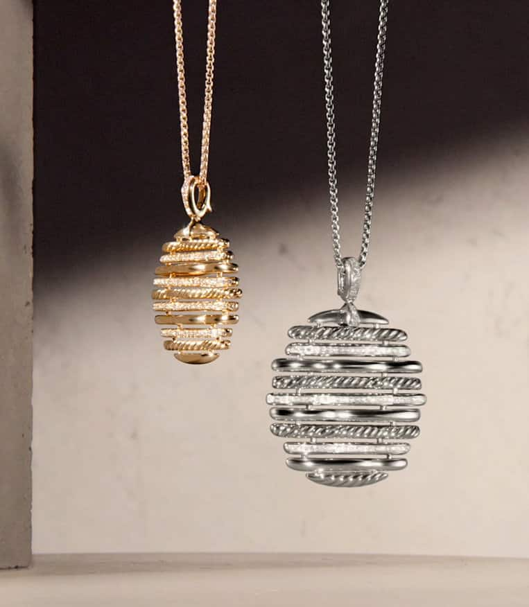 A video of swaying David Yurman Tides pendant necklaces in 18K yellow gold with pavé diamonds or sterling silver with pavé diamonds.