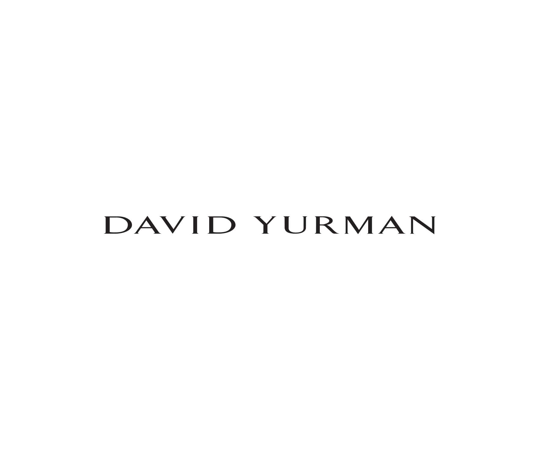David Yurman Cable Collectibles, Helena, Supernova, Continuance with cultured pearl and The Crossover Collection pendant necklaces, in sterling silver or 18K gold with white diamonds, hanging in a ray of light against a sandy-colored stone.