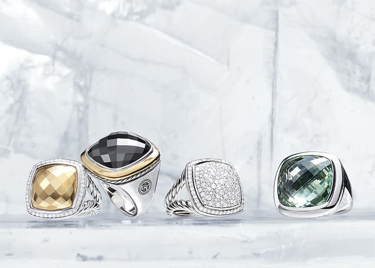 Albion rings in sterling silver with bonded gold dome and pavé white diamonds, 18K yellow gold and black onyx, mosaic pavé white diamonds or prasiolite, in a row on ice.