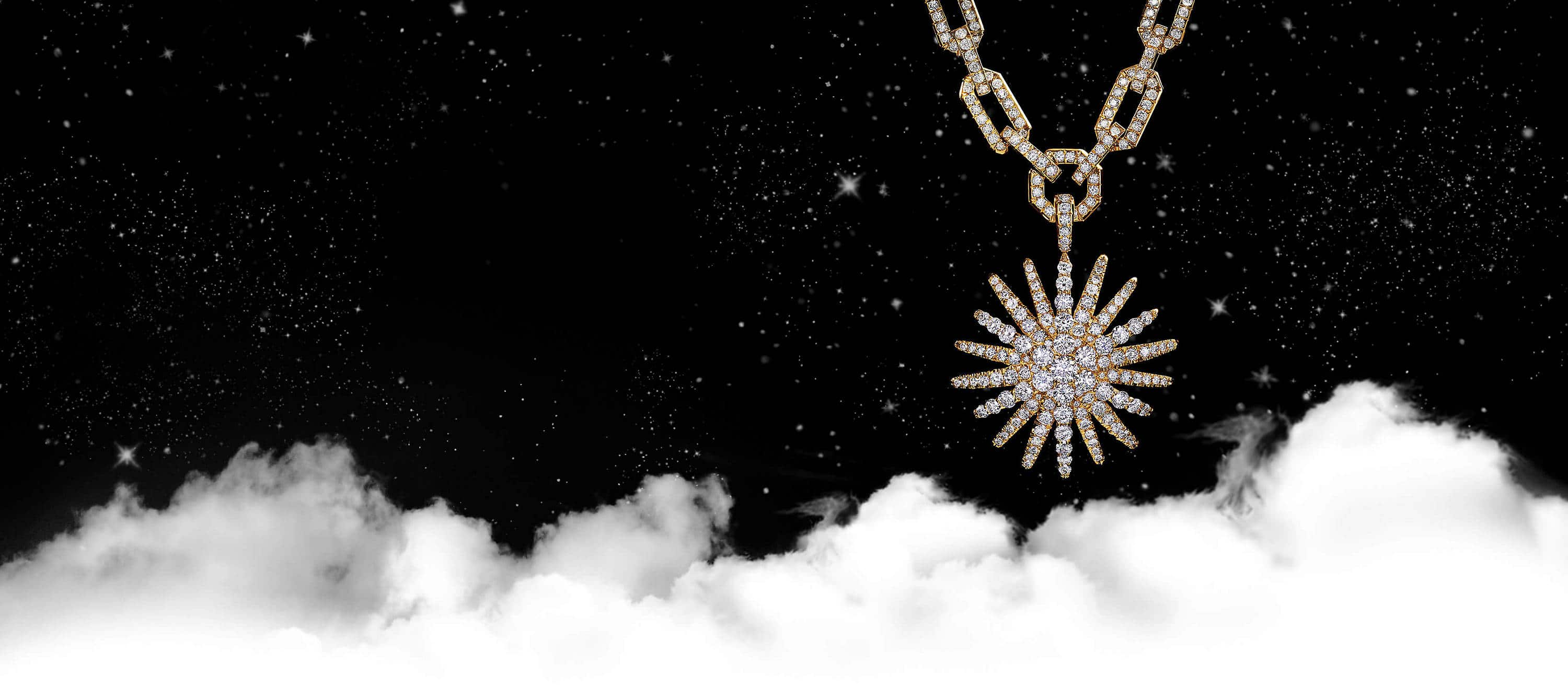 A color photo shows a David Yurman Starburst pendant hanging from a diamond-encrusted chain in front of a starry night sky with white clouds. The women's jewelry is crafted from 18K yellow gold with pavé diamonds.