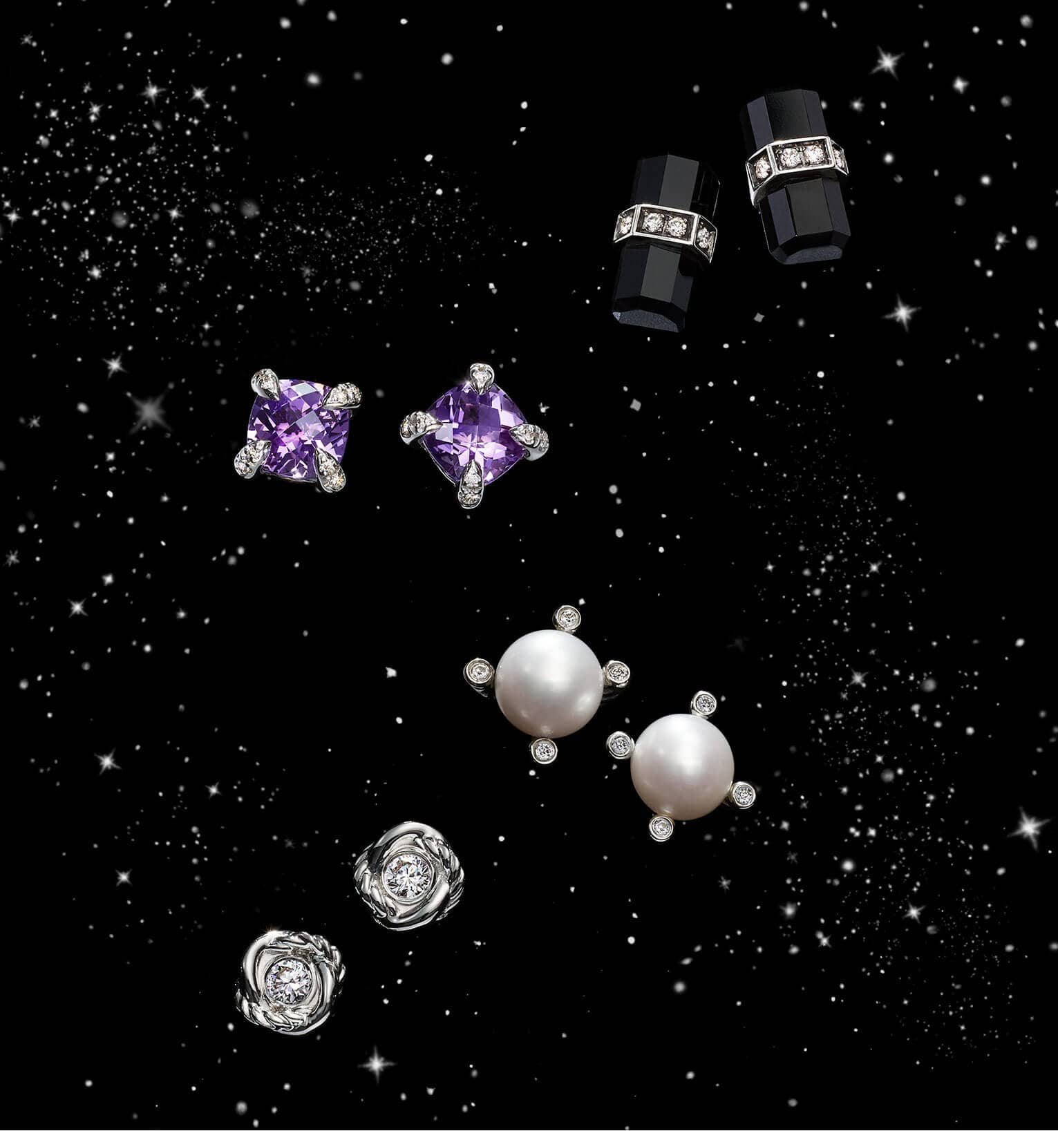 A color photo shows four pairs of David Yurman women's stud earrings from the Châtelaine, Lexington, Cable Collectibles and Infinity collections floating in a starry night sky. The earrings are crafted from sterling silver with pavé diamonds, black onyx, amethyst or cultured pearls.
