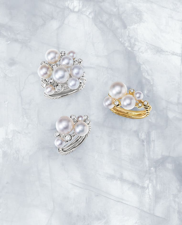 Pearl Cluster rings in sterling silver or 18K yellow gold with cultured freshwater pearls and diamonds on a sheet of ice.