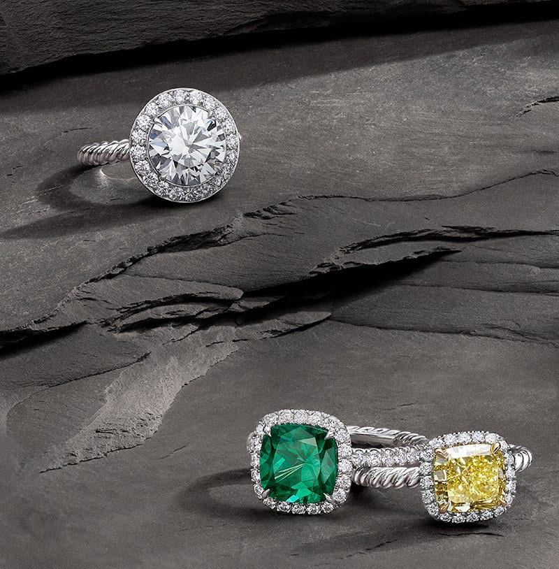 DY Capri® engagement rings in platinum with pavé diamonds and a white diamond, emerald or yellow diamond center stone on a stone.