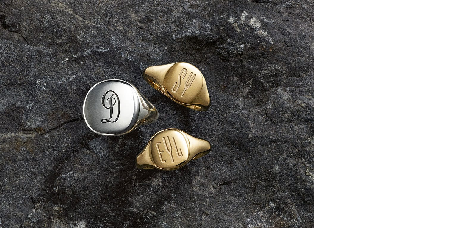 David Yurman Pinky Rings in sterling silver and 18K yellow gold with custom-engraved monograms.