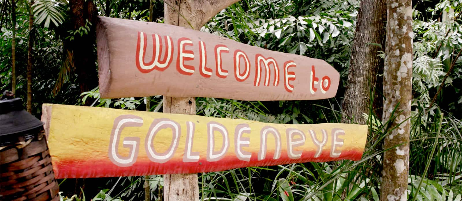 "A sign colorfully painted with ""Welcome to GoldenEye."""