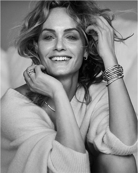 A black-and-white photo of model Amber Valletta wearing David Yurman Tides jewelry in sterling silver with diamonds.