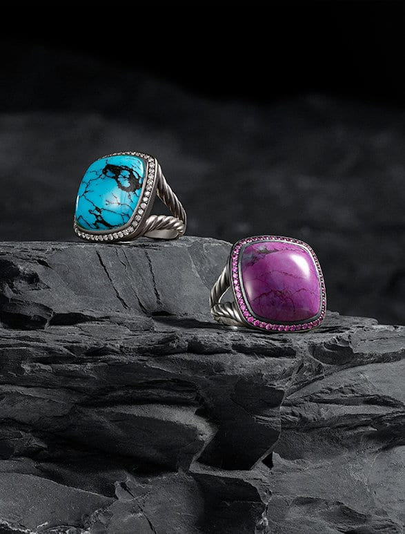 A close-up shot of the turquoise and pavé diamonds on a David Yurman Albion® ring next to a photo of two Albion® rings in sterling silver shot on a dark stone.