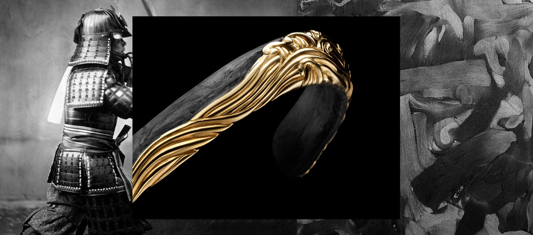 A color photo shows two David Yurman men's Waves rings balanced atop a large piece of forged carbon with another piece of forged carbon in the background behind the rings. The jewelry is crafted from sterling silver with 18K yellow gold accents that depict ocean waves and birds flying in the sky. The right on the right features black pavé diamonds.