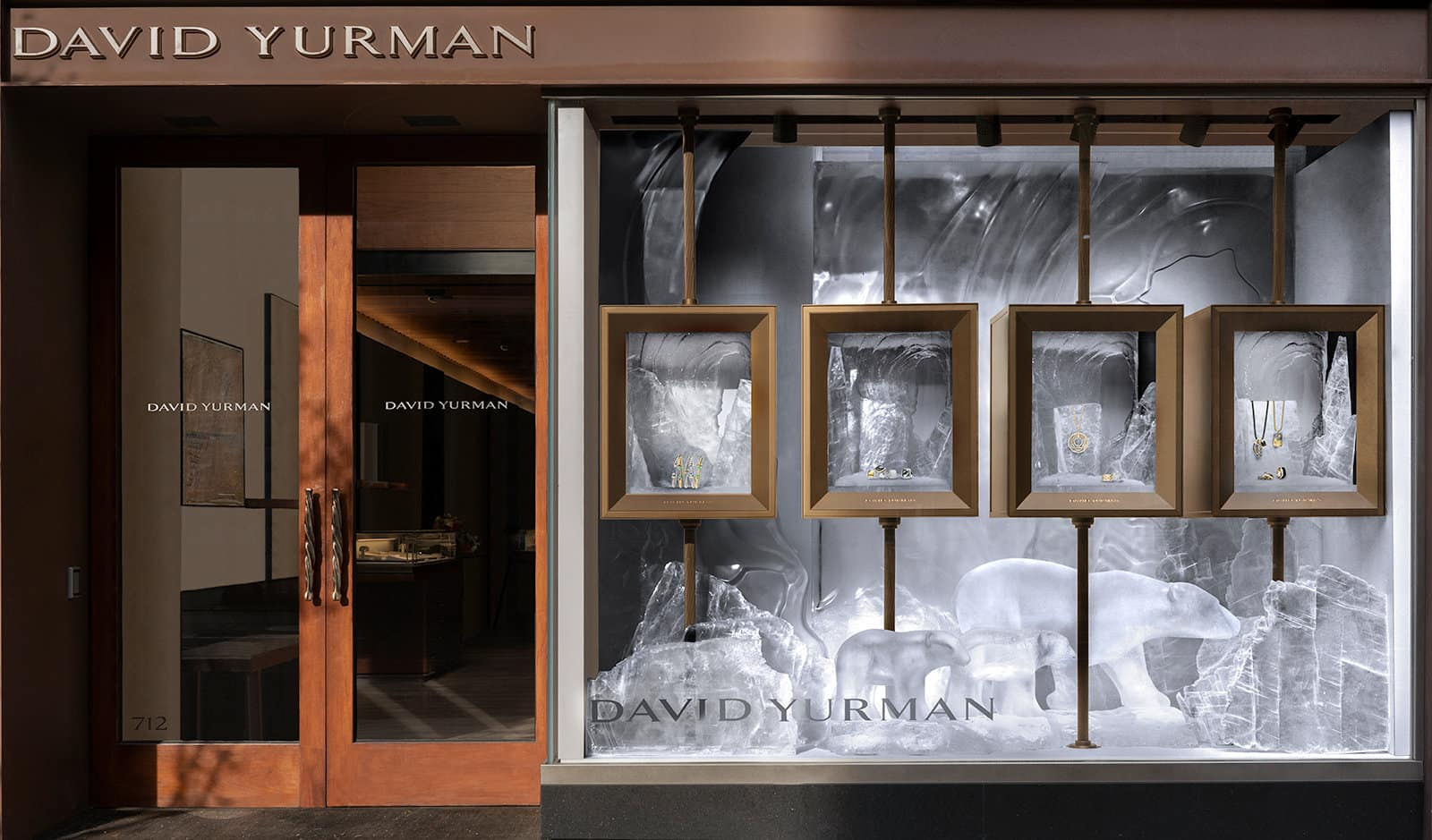 A photograph of the 2018 David Yurman holiday windows with an icy landscape, polar bears carved from selenite and jewelry.