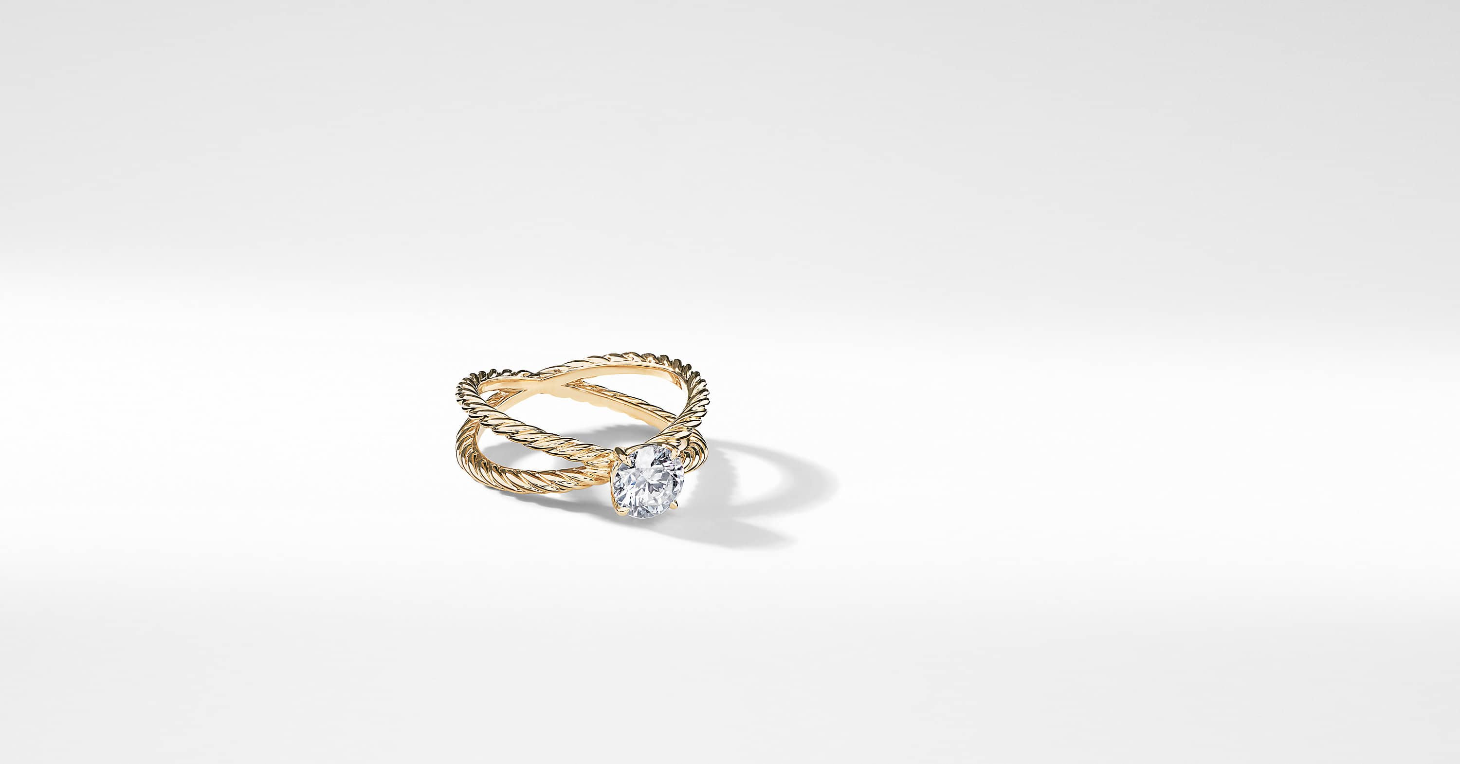 DY Crossover Petite Engagement ring in 18K Yellow Gold, Round