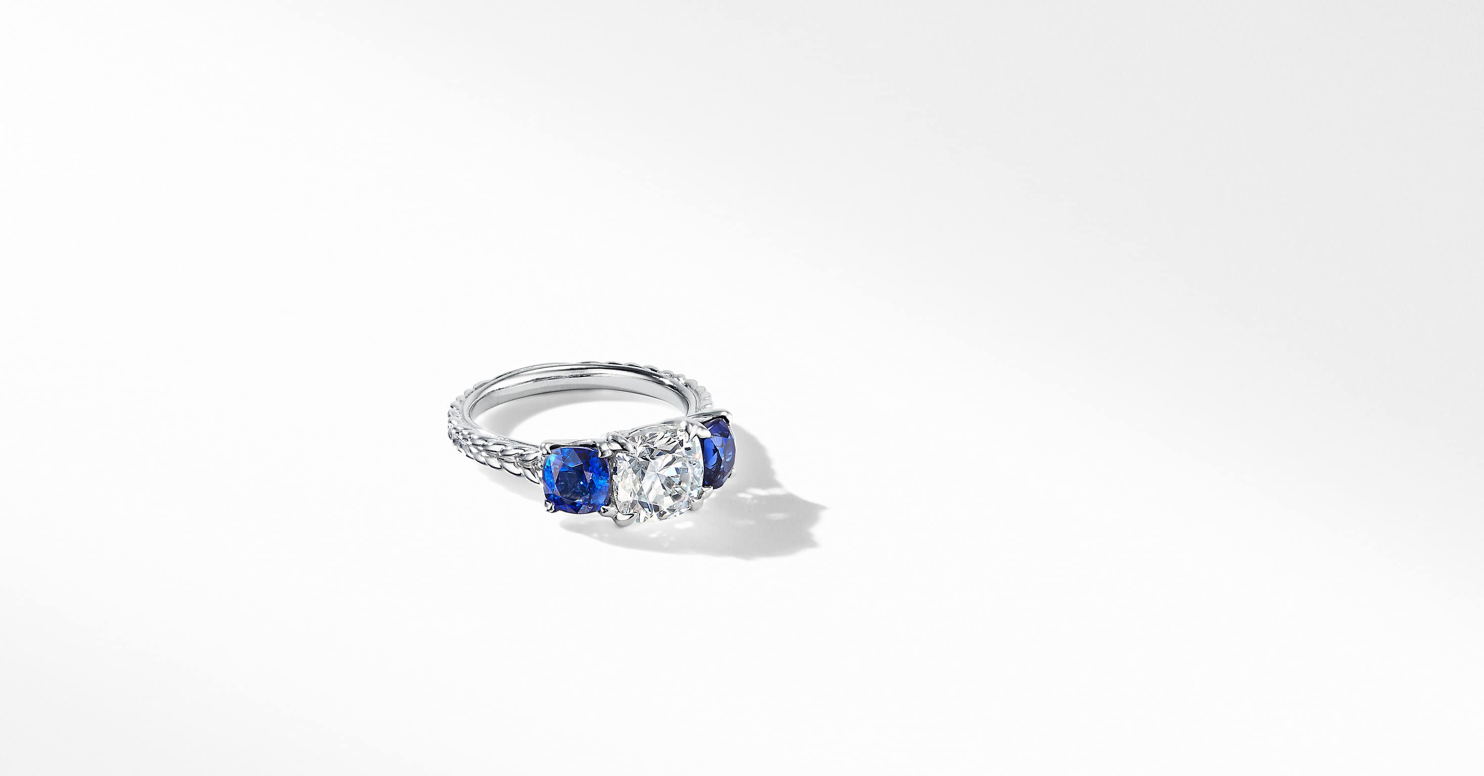 DY Three-Stone Engagement Ring in Platinum with Blue Sapphires, Cushion