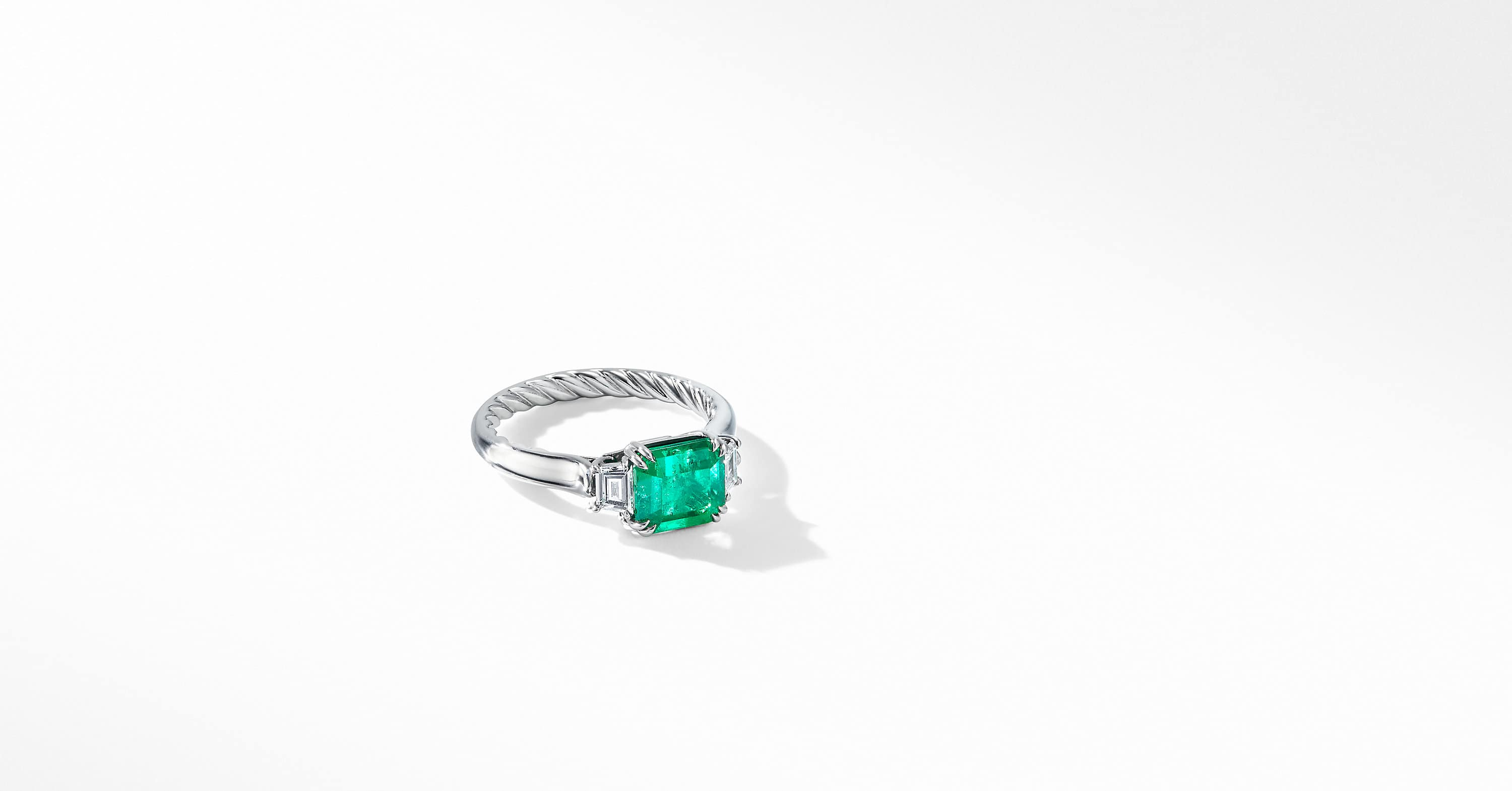 DY Three-Stone Engagement Ring in Platinum, Emerald