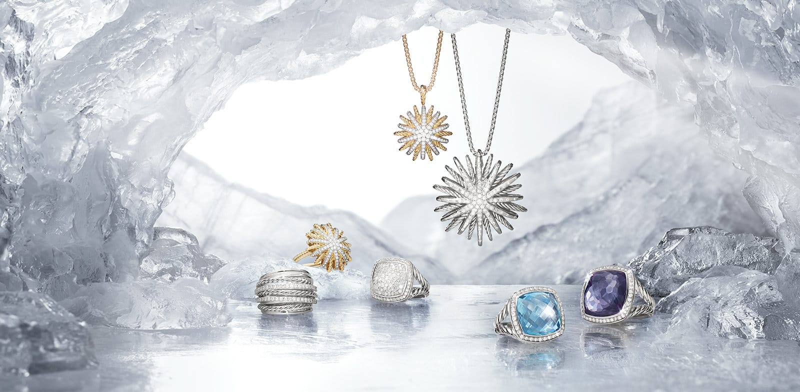 An animated image of snow falling in front of The Cable Collection®, Barrels, Continuance®, Pure Form® and Stax bracelets in 18K yellow gold with or without diamonds in a row within a bright ice cave.